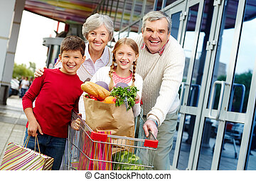 Family of shoppers - Portrait of happy grandparents and...