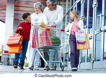 Consumers walking - Portrait of happy grandparents and...