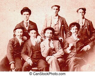 1890s MALE GROUP PHOTO - A group of seven men pose for a...