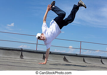 street dancer outdoors - portrait of a young male street...