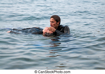 Diving rescue - Diver giving CPR to a diving casualty