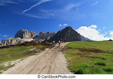 cycling on Dolomites - biker on high mountain road, Italian...