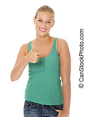 Happy young blond woman gesturing OK. Isolated on white...