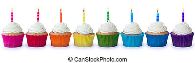 Birthday cupcakes - Row of brightly colored cupcakes...