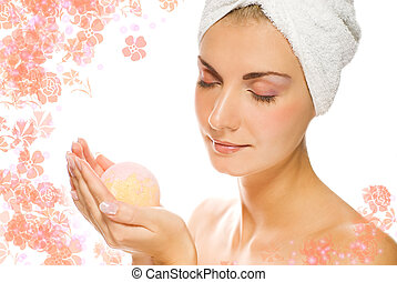 Lovely young woman with aroma bath ball in her hands.