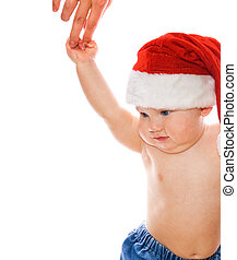 Adorable toddler in Christmas hat holding mother's hand