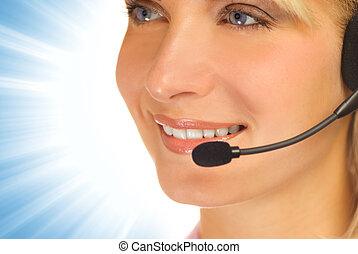 Beautiful hotline operator with headset on abstract...