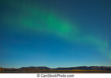 Northern lights and fall colors in moon-lit night - Northern...