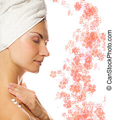 Young lovely lady applying moisturizer to her skin after shower on abstract floral background
