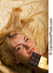 Beautiful girl with a chocolate craving close-up portrait -...
