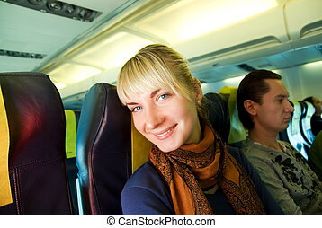 Happy passanger in aircraft