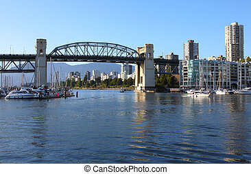 Burrard bridge and marina at sunset.
