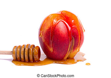 peach with honey dipper - Close up view of a peach with a...