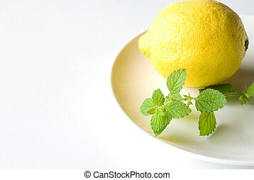 Lemon balm and Lemon - Lemon balm leaf and Lemon on the...