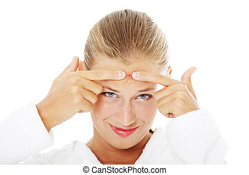 Young teenage woman with pimple on her face Isolated on...