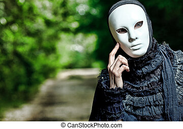 fantasy - Shot of a woman in mask wearing old-fashioned...
