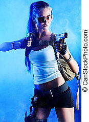 fight - Shot of a sexy military woman posing with guns
