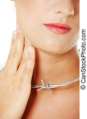 Throat pain concept. Young woman with barbed wire around her...