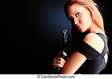 secret agent - Shot of a beautiful woman posing with a gun