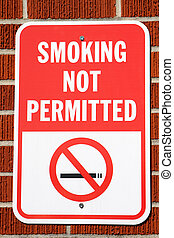 Smoking Not Permitted Sign - Sign hangs on a brick wall...