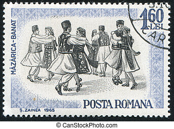 Folk Dancers - ROMANIA - CIRCA 1966: stamp printed by...