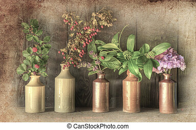Still life image of dried flowers in rustic grunge retro vase against weathered wooden background