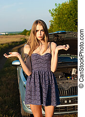 confused girl did not know what to do with a car that broke...