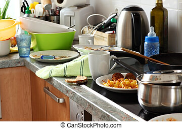 Dirty kitchen - Pile of dirty dishes in the kitchen -...