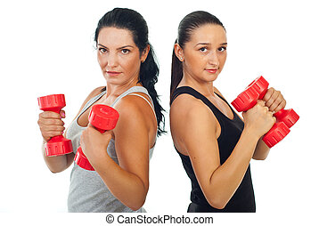 Fitness women holding dumb bell - Two beauty fitness women...