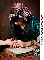 Palmistry hand-reading - Young palmister reading the future...