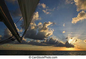 Majestic sunset from sailboat - A majestic sunset over...
