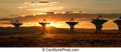 Satellite Dishes at Sunset - Satellite dishes in the Very...