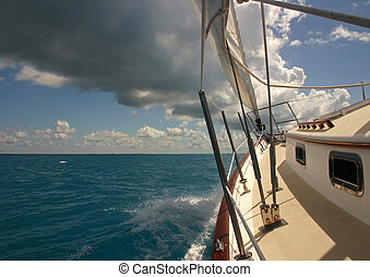 Sailing in stormy weather in tropical climate - Sailing in...