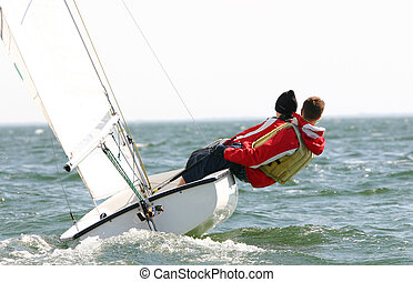 Young Dinghy Sailors - Two young dinghy sailors compete in...