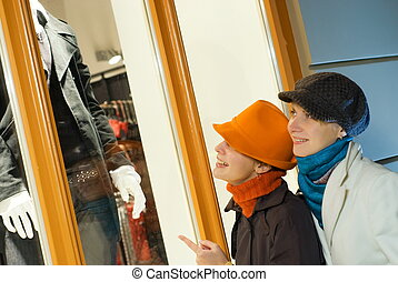 Two girls near the shop window
