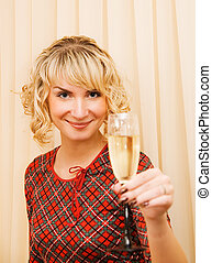 Beautiful girl with a glass of champagne