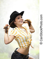 smiling woman with cowboy hat - A smiling beautiful brunette...