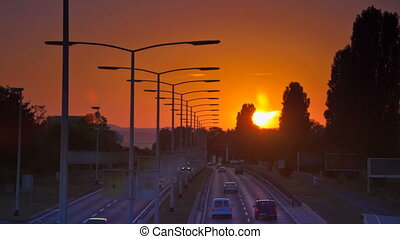 Car Driving on highway at sunset