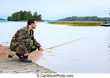 Fisher on lake shore