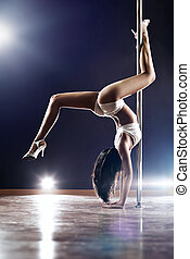 Young slim woman - Young slim pole dance woman