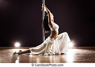 Young pole dance woman - Young slim pole dance woman...