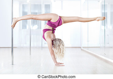 Young pole dance woman