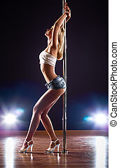 Young sexy woman - Young sexy pole dance woman.