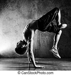 Young man sports exercises Contrast black and white