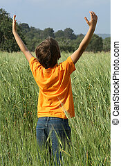 happy summer child arms raised to the sky and sun