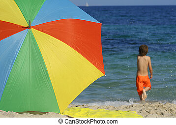 beach summer vacation on holiday with colourful sunshade