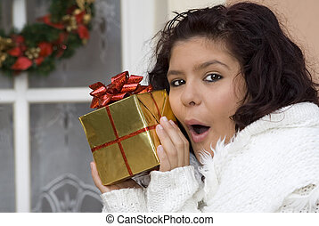 excited girl with surprise gift or present