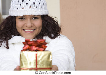 happy girl giving christmas holiday or birthday gift or present