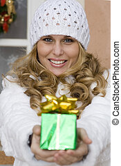 woman giving christmas holiday gift or present