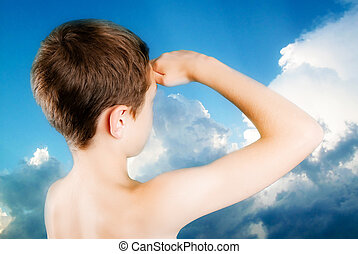 child observes a restless  sky